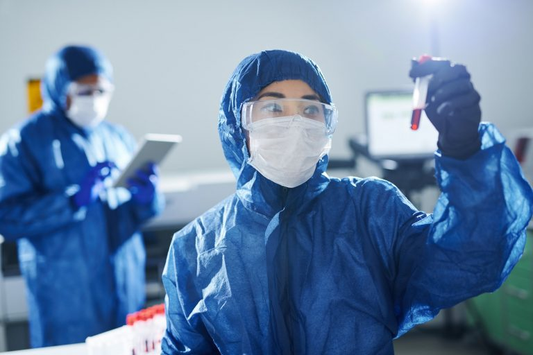 Healthcare scientist working with dangerous sample